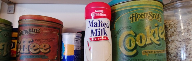 A container of malted milk on shelf